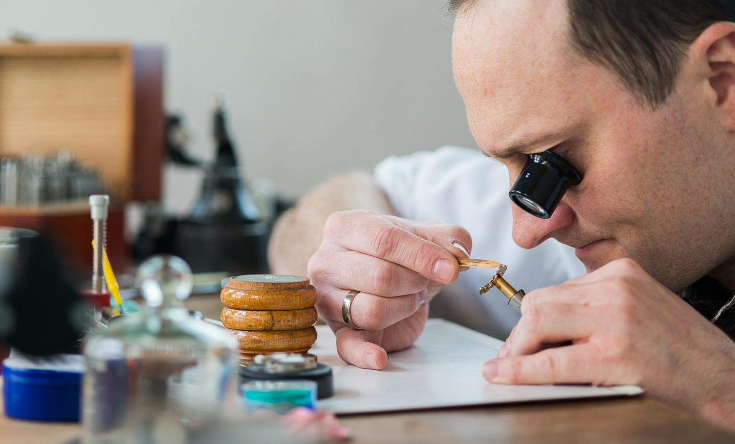 Daniel Malchert beveling the edges of a three-quarter plate